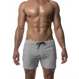 Wholesale men short pants skulls resale online – Muscle skull shorts beach pants new summer stretch slim beach pants quick drying training swimming shorts for men