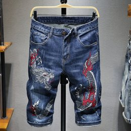 Discount summer wash coat 2020 Fashion Dragon Embroidered Hole Denim Shorts Men's Cotton Slim Pants Summer Retro Washed Blue Straight Jeans S