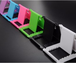 standing holder tablet UK - wholesale Universal Multi-angle phone holder multi-position foldable creative desktop Folding Smartphone tablet stand fast dhl shipping