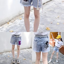 Wholesale raw wash jeans resale online - 2020 Summer Girl Shorts hot pants outer versatile raw cut washed ripped denim shorts in the big kids denim hot pants