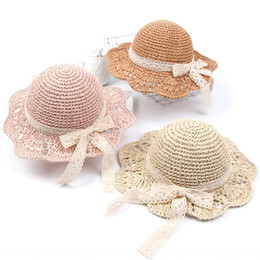 shades christmas Australia - Babies' shade lace bow sun Straw sun lace straw hat sunscreen hollow breathable foldable hat girls