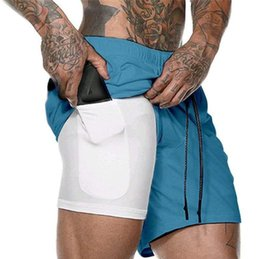 wearing compression shorts NZ - Mens Sports Basketball Gym Compression Phone Pocket Wear Under Base Layer Short Pants Athletic Solid Tights Shorts Running Pants