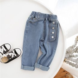 bohemian style boots Australia - INS Korean Style Newest Kids Girls Jeans Denim Trousers Autumn Fashions Buttons Pockets Designer Elastic Waist Autumn Children Unisex Pants