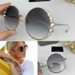 Discount pearl popping 2020 New fashion designer women 0288 sunglasses round metal frame with luxurious pearl avant-garde pop style uv 400 prot