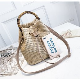 bamboo hand bags NZ - Bamboo New style hand-held Two colors Leisure Bucket shaped woven Versatile women's bag single shoulder diagonal straddle bag