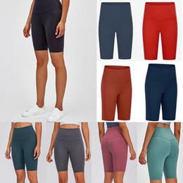 Venta al por mayor de diseñador de las mujeres de yoga gimnasio de entrenamiento para mujer desgaste lu 68 deportes del color sólido elástico Señora de la aptitud general medias llenas corta polainas 26qda590af #