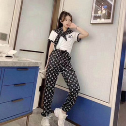 Wholesale new fashionable pants resale online – The new web celebrity in is the same style embroidered black and white fashionable T shirt black printed pants suit as a gift scarf