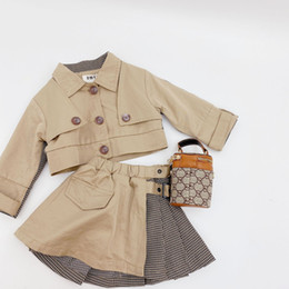 Wholesale pleated trench coats resale online - Designer style kids trench coat outfits fashion new children lapel plaid patchwork khaki short trench coat pleated skirts sets A3685