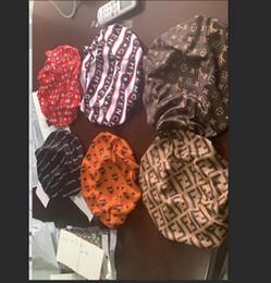 Venta al por mayor de Diseñador Durag mujeres musulmanes estiramiento del sueño turbante sombrero de la bufanda sedosa capo Chemo Gorros Caps cáncer Headwear abrigo de la cabeza accesorios para el pelo