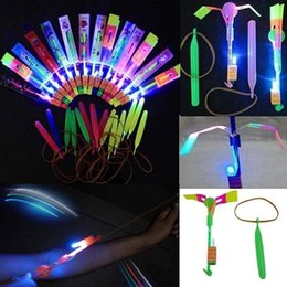 amazing flying helicopter wholesale UK - Lowpricenice Amazing Led Light Arrow Rocket Helicopter Flying Toy Party Fun Gift Elastic