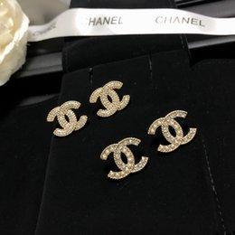 Ingrosso orecchino con perla di design e forma cava per il regalo di nozze le donne di modo degli orecchini gioielli di vendita calda XX027
