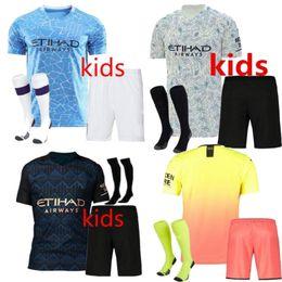 Wholesale short socks resale online - 2020 Manchester KUN AGUERO STERLING MAHREZ JESUS DE BRUYNE MAN CITY kids kit soccer jersey Child football shirts uniforms kits socks