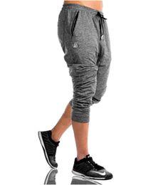 Wholesale compression wear for sale – plus size JS1722J Workout fitness men Short sleeve t shirt men thermal muscle bodybuilding wear compression Elastic Slim exercise clothing