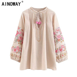 Discount cute spring blouses Spring women bohemian tassel shirt cute beach floral embroidery linen cotton blouse shirt flare sleeve loose Boho blusas
