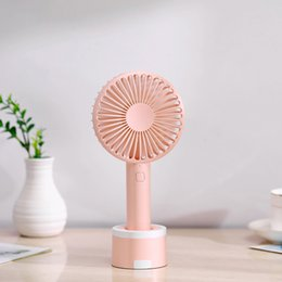 Discount quality hand fans wholesale Hand-Held Portable Cartoon Base Fan Mini New Style USB 1200mAh Electric Fan With mobile phone stand High Quality and Bra