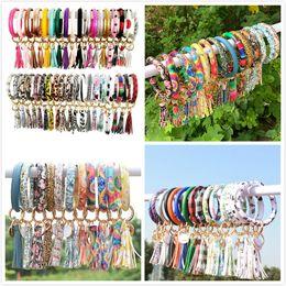Hot Multiple Styles Sun Flower Flag Pattern Leather Wrap Tassels Bracelets Keychain Wristlet Bracelet Tassel Keychain Round Bangle Key Ring on Sale