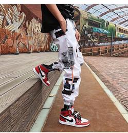 Wholesale fans pants for sale - Group buy 20SS new Men s hip hop fans casual pants black and white graffiti pattern loose cargo pants high quality men s pants