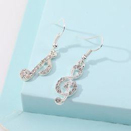 animals symbol Australia - Korean temperament asymmetric diamond and notes alloy earrings women's personalized all-match symbols diamond-encrusted geometric earrings K
