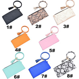 ladies handbags designer Canada - Portable Bracelet Key Ring Handbag Fashion Bracelet Tassel Wallet Leather PU Wrist Round Key Chain Ladies Clutch Purse AccessoryVT1438