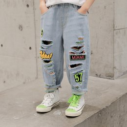 hip hop style ripped jeans NZ - fHDM6 2020 casual and jeans boys' summer new ripped jeans Western style boys' hip-hop street dance pants Korean style casual pants for mediu