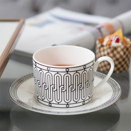 VIP Dropshipping Elegante H Mark Golden Top Grade Bone China tazza da caffè di tè Coppa Europa Set e piattino pomeriggio per tè e caffè in Offerta