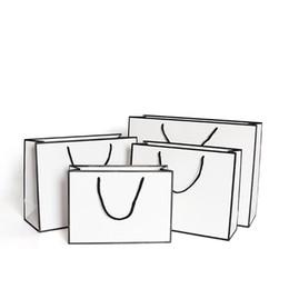Wholesale craft shops resale online - White Present Paper Bags Kraft Card Packaging Bag Cloth Fashion Storage Handbag Thickening Shopping Advertising Custom gr B2
