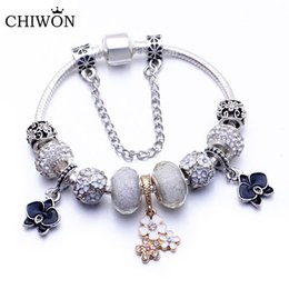 tibetan crystal charms NZ - Magnolia charm bow big hole beaded accessories European and American Tibetan silver fashion DIY inlaid crystal bracelet