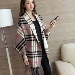 Wholesale geometric shawl cape for sale - Group buy New product women s autumn and winter fashion mid length bat sleeve cape tassel knitted cardigan sweater women s coat shawl scarf jacket