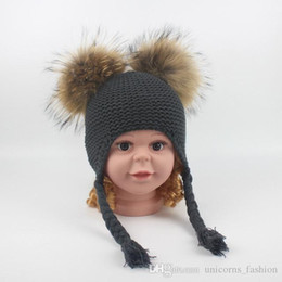 kids rain hats NZ - Knitted Hat Children Cute Winter Hats Two Faux Raccoon Fur Pompom Hat Boy Knitted Cap Warm Ears Earflap Thick Kids Beanies CNY976