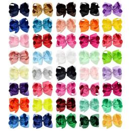40 cores vendeu bem Europeu e do cabelo Bow da American 6 Inch clip crianças Headpiece cor doce Warped Flores Meninas Grande bowknot Barrette em Promoção