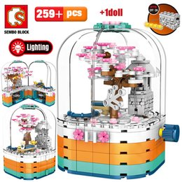 led cherry lights UK - SEMBO Creative LED Light Rotating Box Building Blocks Friends City Street View Cherry Blossom House Tree Bricks Toys for Kids