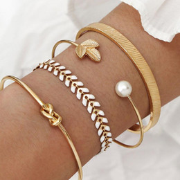 gold bone link chain Canada - 4 Pcs Set Gold Color Knot Pearl Charm Bracelets Bangles Set for Women Dragon Bone Link Chain Bracelets Open Cuff Braclets Girls