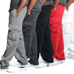 Опт Мужчины дизайнерские свободные пробежки сплошные цветные гусеницы брюки случайные брюки мода спортивные грузовые карманы брюки плюс размер