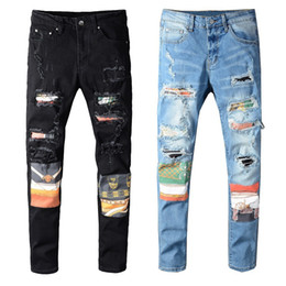 Uomini Jeans New Fashion Mens Stylist Black Blue Jeans Skinny Skinny RIPED DESTRASTO STRETTO SLIG FIT HOP HOP Pantaloni con fori per gli uomini in Offerta