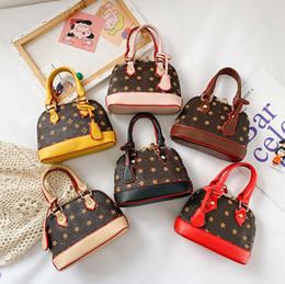Venta al por mayor de Moda niños shell bolso de lujo niños impreso PU cuero de cuero cadena bolsa muchachas solo hombro bolsa diseñador mujeres mini lápiz labial bolso A4601