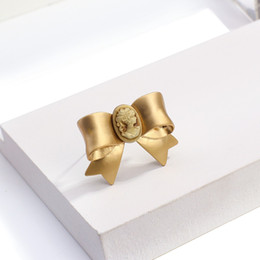 wholesale t shirts china Canada - Metal Bow Brooches for Women Matte Gold Color Small Bowknot Women Pins Summer Dress T-shirt Accessories New Design 2020
