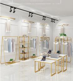 Wholesale Light luxury clothing display rack Commercial Furniture women's cloth store racks upper floor type side hanging show shelf