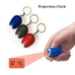 Venta al por mayor de Nuevo reloj electrónico de proyección electrónica LED reloj digital Mini reloj de proyección portátil Flashlight Llavero Keychain reloj de proyección