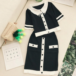 2pcs set Woman suits black and white contrast color buttons knitted Shirt Short-sleeved Pullover Tops + thin package hip Skirt iCF1#