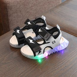 led cone lights UK - Kids LED Sandals Light up Children Summer Shoes Glowing Sport Sandals Boys and Girls Flashing Soft beach shoes for Toddlers C1002