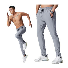 Discount men workout leggings Men Jogging Pants Running 2020 Men Sport Long Gym Leggings Quick Dry Workout Trousers With Pocket Training Soccer Pants