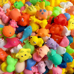 Wholesale cartoon animal fish bath toys colorful soft rubber playing swimming water toys for baby squeeze sound classic toys