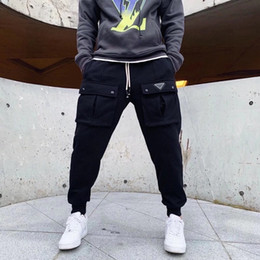 Wholesale work pants resale online - 20ss men pant work street casual sweatpants loose Imported woven waterproof fabric Feel smooth Eye decoration solid color black pants