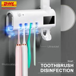 Подставка для зубных щеток УФ-стерилизатор Автоматического дозатор зубной пасты Новых солнечного ультрафиолетовых Автоматического дозатор зубной пасты Antibacteria Свободного DHL на Распродаже