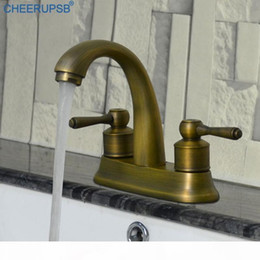 vintage faucet handles Australia - Vintage Basin Gold Faucet Bathroom Hot Cold Water Mixer Tap Dual Hole Double Handle Faucets Ceramic Spool Brushed Brass Taps