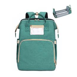 Опт Корабль из США склад Многофункциональный детский складной кроватя кроватями подгузник сумка мамы и папы USB рюкзак для материнства коляска