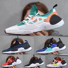 2020 Huarache 7.0 E.D.G.E.TXT QS Chaussures de course pour Hommes Femmes Sneakers Blanc Noir Triple Huaraches Chaussures de sport EUR36-45 en Solde