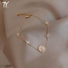 2021 New Mode Micro Zirkoon Korean Women's Jewelry Classic Alloy Plum Blossom Cross Shape Bracelet on Sale