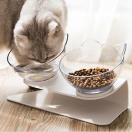 Venta al por mayor de Doble gato perro cuencos alimento mascota agua cuenco antideslizante protección columna vertebral multiusos mascotas alimentación cuenco oceano buque caja paquete HAA1700