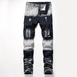 Wholesale design jeans resale online - Men Ripped Jeans Fashion Motorcycle denim Design Slim Fit Straight Jeans Brand Casual Patches Men s Fashion Wear Pants